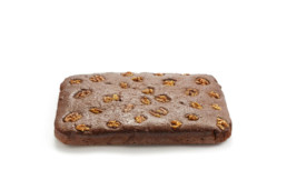 Brownie sponge cake decorated with walnuts