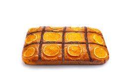 Orange sponge cake decorated with orange slices